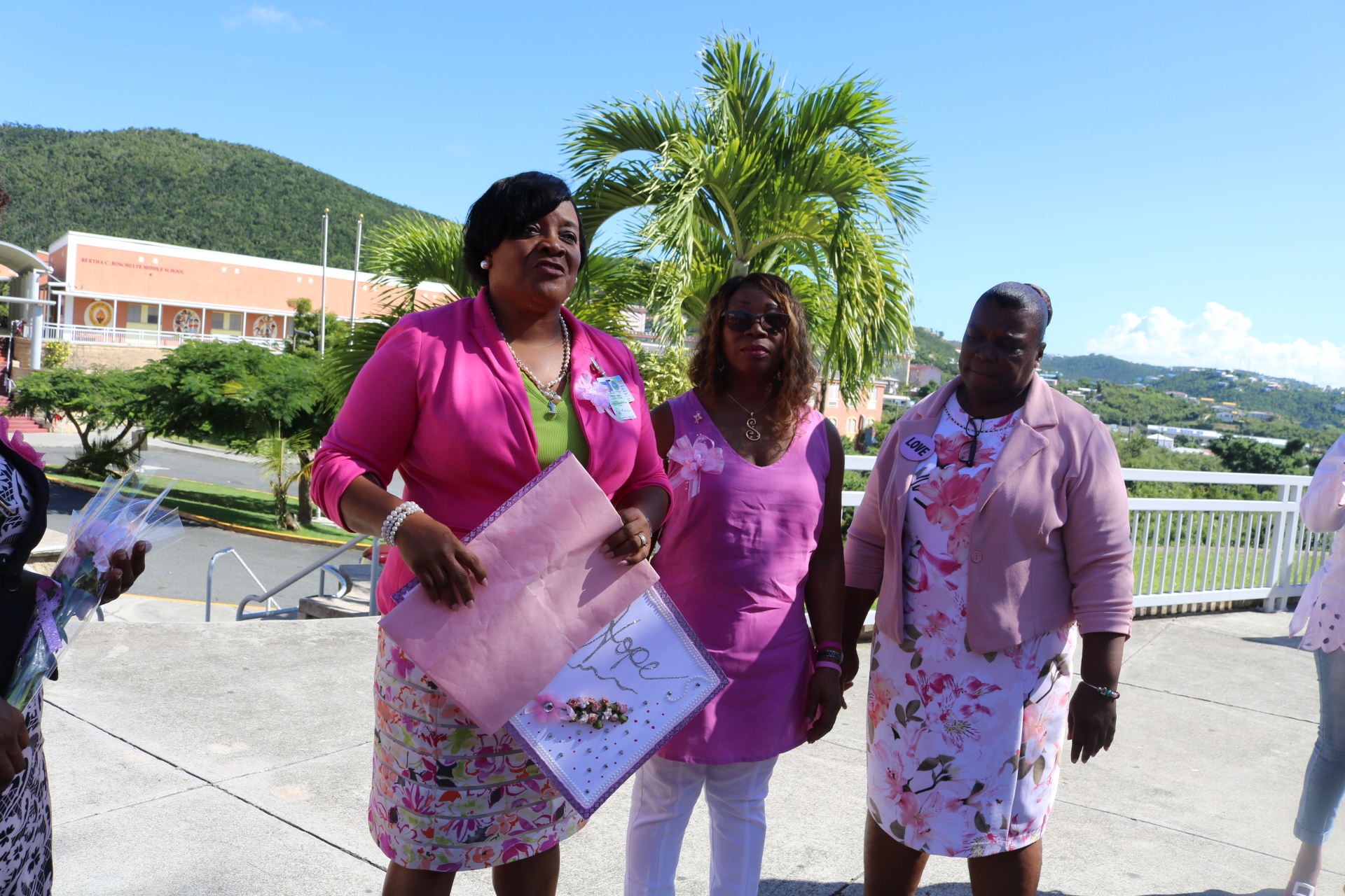 Assistant Principal Dr. Merlene Jones [L] presents Margarita Charles-Smith [C] with card alongside Assistant Principal Michelle Wilkinson [R].jpeg